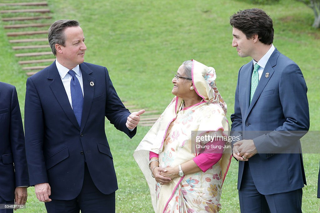 British Prime Minister <a gi-track='captionPersonalityLinkClicked' href=/galleries/search?phrase=David+Cameron+-+Politicus&family=editorial&specificpeople=227076 ng-click='$event.stopPropagation()'>David Cameron</a> talks with Bangladesh Prime Minister Sheikh Hasina (C)and Canadian Prime Minister <a gi-track='captionPersonalityLinkClicked' href=/galleries/search?phrase=Justin+Trudeau&family=editorial&specificpeople=2616495 ng-click='$event.stopPropagation()'>Justin Trudeau</a> (R) during a outreach Photo session on May 27, 2016 in Kashikojima, Japan. In the two-day summit, the G7 leaders are scheduled to discuss the pressing global issues including counter-terrorism, energy policy, and sustainable development.