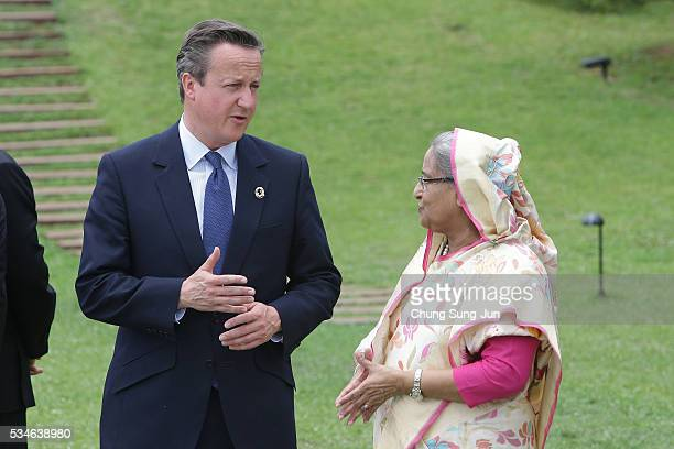 British Prime Minister David Cameron talks with Bangladesh Prime Minister Sheikh Hasina attend the 'Outreach Family Photo Session' on May 27 2016 in...