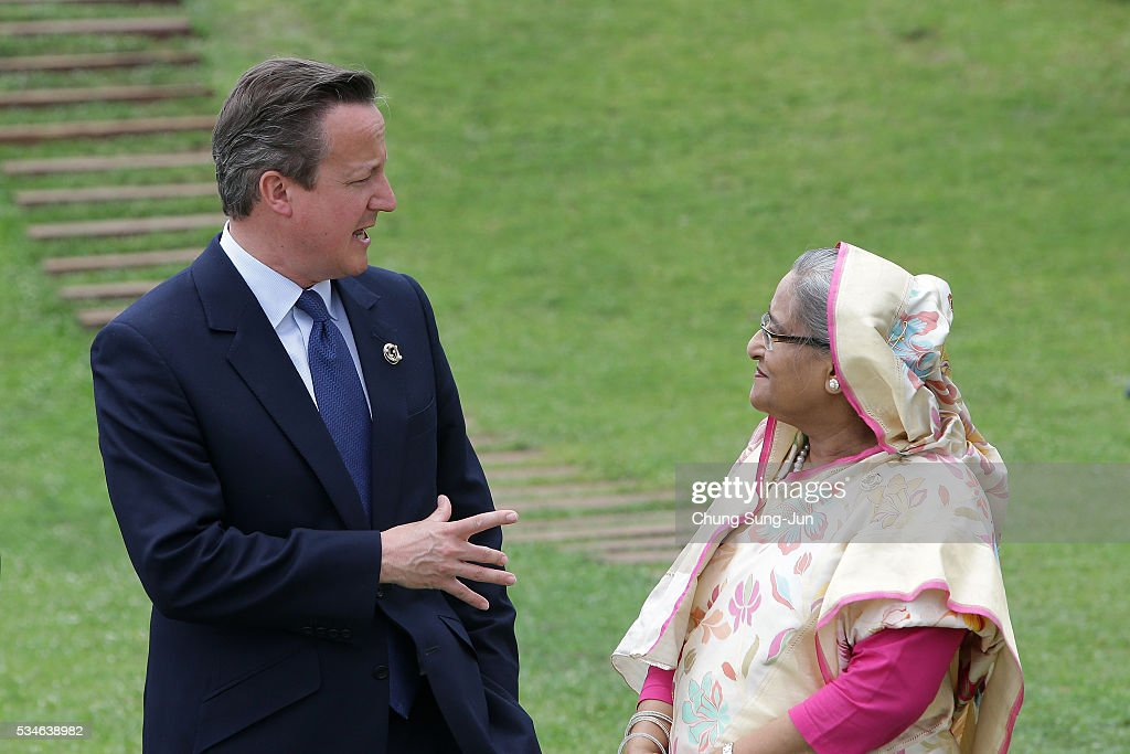 British Prime Minister David Cameron talks with Bangladesh Prime Minister Sheikh Hasina attend the 'Outreach Family Photo Session' on May 27, 2016 in Kashikojima, Japan. In the two-day summit, the G7 leaders are scheduled to discuss the pressing global issues including counter-terrorism, energy policy, and sustainable development.