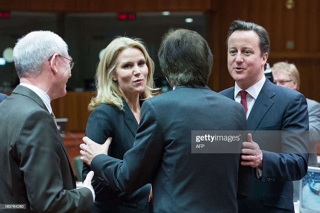 British Prime Minister David Cameron (R) talks with Danish Prime Minister Helle Thorning-Schmidt (2ndL), European Council President Herman Van Rompuy (L) prior to a roundtable meeting at the EU Headquarters on March 15, 2013 in Brussels, on the second day of a two-day European Union leaders summit. EU leaders hold a second and final day of summit talks from with attention turning to relations with Russia.