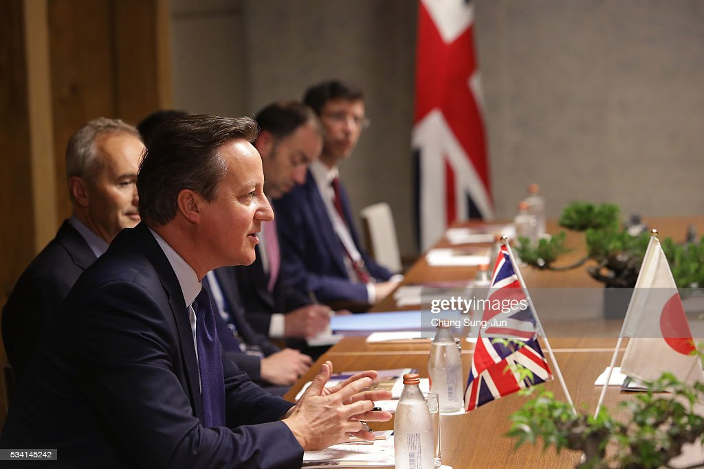 British Prime Minister <a gi-track='captionPersonalityLinkClicked' href=/galleries/search?phrase=David+Cameron+-+Politician&family=editorial&specificpeople=227076 ng-click='$event.stopPropagation()'>David Cameron</a> talks with Japanese Prime Minister Shinzo Abe (not seen) during a bilateral meeting on May 24, 2016 in Shima, Japan. The G7 summit will be held on Japan's Kashikojima Island on May 26 and 27, 2016.