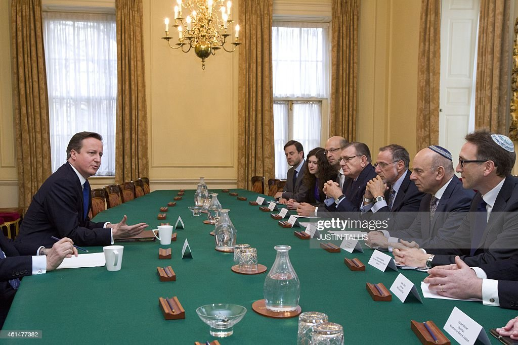 British Prime Minister <a gi-track='captionPersonalityLinkClicked' href=/galleries/search?phrase=David+Cameron+-+Politician&family=editorial&specificpeople=227076 ng-click='$event.stopPropagation()'>David Cameron</a> (L) talks with <a gi-track='captionPersonalityLinkClicked' href=/galleries/search?phrase=Mick+Davis&family=editorial&specificpeople=240575 ng-click='$event.stopPropagation()'>Mick Davis</a>, Chairman of the board of trustees (3R) and Vivian Wineman, President of the Board of Deputies (2R), along with other members of the Jewish Leadership Council including Gerald Ronson (4L) and Jonathan Goldstein (R) during their annual meeting at 10 Downing Street in London on Janurary 13, 2015.