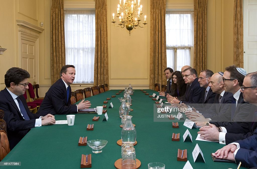 British Prime Minister <a gi-track='captionPersonalityLinkClicked' href=/galleries/search?phrase=David+Cameron+-+Politician&family=editorial&specificpeople=227076 ng-click='$event.stopPropagation()'>David Cameron</a> (L) talks with <a gi-track='captionPersonalityLinkClicked' href=/galleries/search?phrase=Mick+Davis&family=editorial&specificpeople=240575 ng-click='$event.stopPropagation()'>Mick Davis</a>, Chairman of the board of trustees (4R) and Vivian Wineman, President of the Board of Deputies (3R), along with other members of the Jewish Leadership Council including Gerald Ronson (4L) and Jonathan Goldstein (2R) during their annual meeting at 10 Downing Street in London on Janurary 13, 2015.