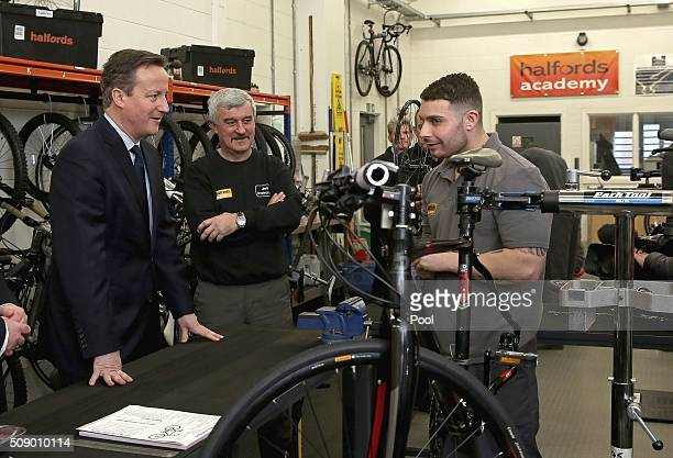 British Prime Minister David Cameron talks with prison inmate 'Chris' inside the Halfords academy during his tour of HM Prison Onley in Rugby central...
