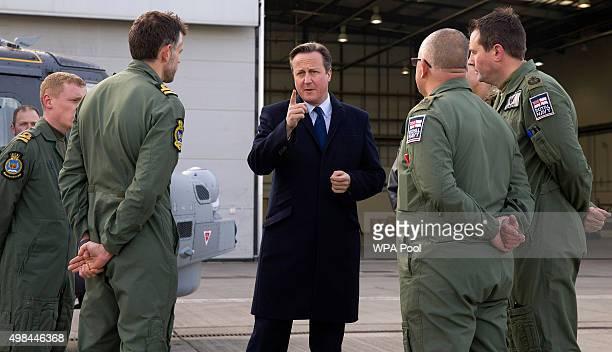British Prime Minister David Cameron talks with Royal Navy personnel during his visit to Royal Air Force station RAF Northolt at RAF Northolt on...