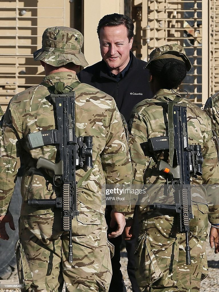 British Prime Minister David Cameron talks with soldiers at Camp Bastion, outside Lashkar Gah on December 20, 2012 in Helmand Province, Afghanistan. Prime Minister Cameron is making a Christmas visit to British troops in the region amid tight security.