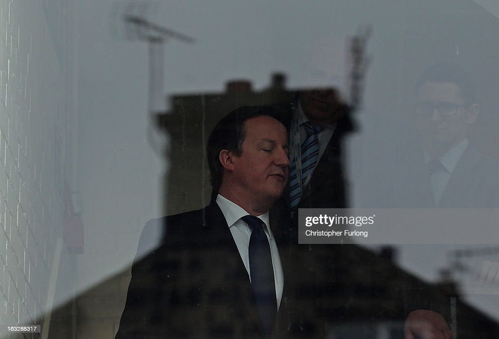 British Prime Minister <a gi-track='captionPersonalityLinkClicked' href=/galleries/search?phrase=David+Cameron+-+Politician&family=editorial&specificpeople=227076 ng-click='$event.stopPropagation()'>David Cameron</a> tours a BT telephone exchange as BT announce that they are creating more than 1,000 engineering jobs in the company's Openreach business on March 7, 2013 in Pudsey, England. During his visit to West Yorkshire the prime minister emphasised that he will hold firm on the economy and that any change in the governments route to economic recovery would plunge the UK 'back into the abyss'.