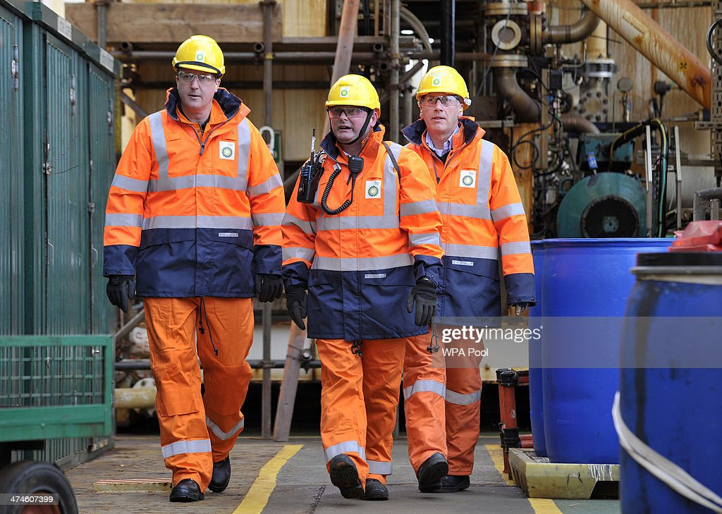 British Prime Minister David Cameron (L) tours the BP ETAP (Eastern Trough Area Project) oil platform in the North Sea with Offshore Installation manager Mark Furness (C) BP Regional president North Sea Trevor Garlick (R) on February 24, 2014, around 100 miles east of Aberdeen, Scotland. The British cabinet will meet in Scotland for only the third time in history to announce plans for the country's oil industry, which it warns will decline if Scots vote for independence. The fate of North Sea oil revenues will be a key issue ahead of the September 18 referendum to decide whether Scotland will end its 300-year-old union with England, and is expected to be the focus of Prime Minister David Cameron's cabinet meeting.
