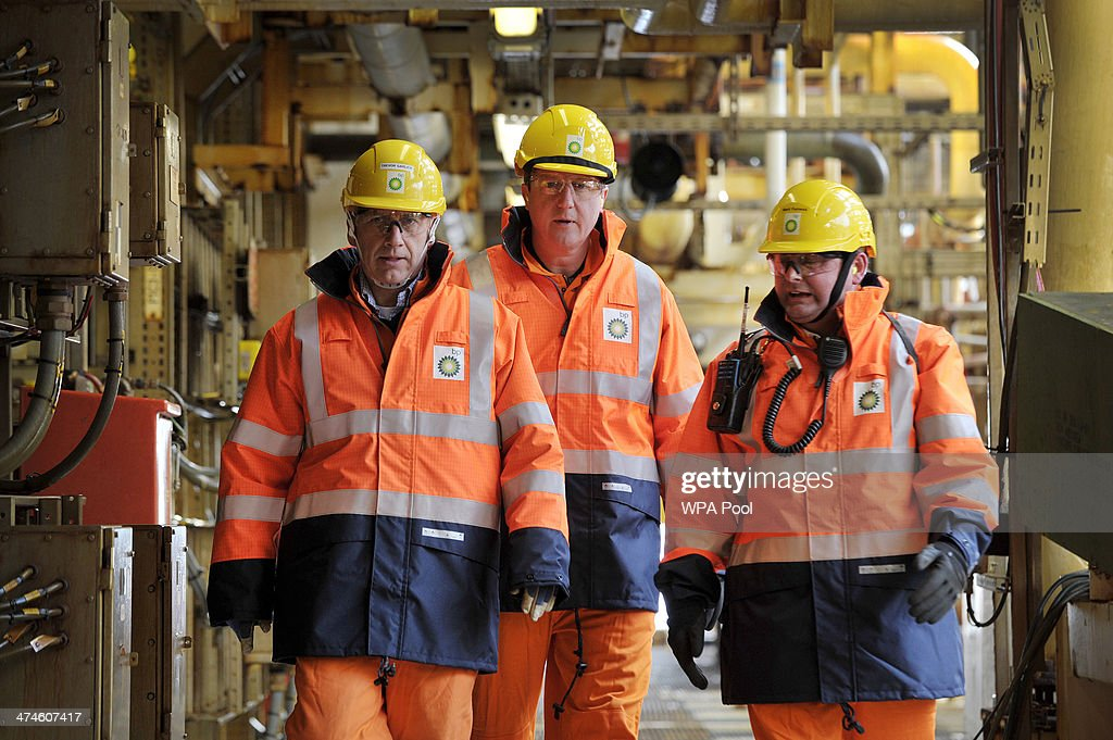 British Prime Minister David Cameron (C) tours the BP ETAP (Eastern Trough Area Project) oil platform in the North Sea with Offshore Installation manager Mark Furness (R) BP Regional president North Sea Trevor Garlick (L) on February 24, 2014, around 100 miles east of Aberdeen, Scotland. The British cabinet will meet in Scotland for only the third time in history to announce plans for the country's oil industry, which it warns will decline if Scots vote for independence. The fate of North Sea oil revenues will be a key issue ahead of the September 18 referendum to decide whether Scotland will end its 300-year-old union with England, and is expected to be the focus of Prime Minister David Cameron's cabinet meeting.