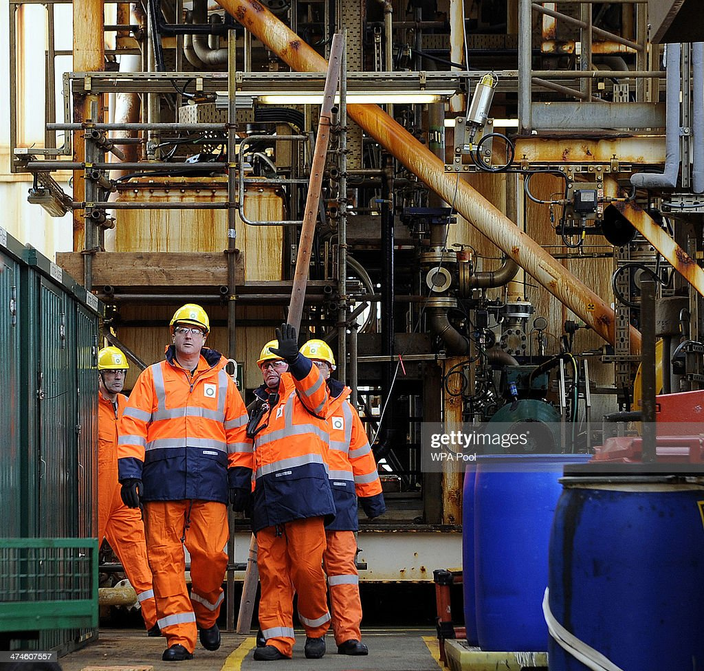 British Prime Minister David Cameron tours the BP ETAP (Eastern Trough Area Project) oil platform in the North Sea with Offshore Installation manager Mark Furness (R) on February 24, 2014, around 100 miles east of Aberdeen, Scotland. The British cabinet will meet in Scotland for only the third time in history to announce plans for the country's oil industry, which it warns will decline if Scots vote for independence. The fate of North Sea oil revenues will be a key issue ahead of the September 18 referendum to decide whether Scotland will end its 300-year-old union with England, and is expected to be the focus of Prime Minister David Cameron's cabinet meeting.