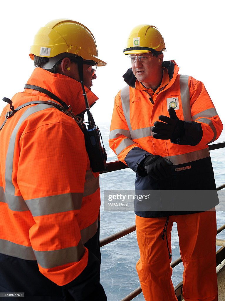 British Prime Minister David Cameron tours the BP ETAP (Eastern Trough Area Project) oil platform in the North Sea with Offshore Installation manager Mark Furness (L) on February 24, 2014, around 100 miles east of Aberdeen, Scotland. The British cabinet will meet in Scotland for only the third time in history to announce plans for the country's oil industry, which it warns will decline if Scots vote for independence. The fate of North Sea oil revenues will be a key issue ahead of the September 18 referendum to decide whether Scotland will end its 300-year-old union with England, and is expected to be the focus of Prime Minister David Cameron's cabinet meeting.
