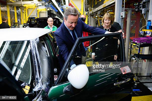British Prime Minister David Cameron flanked by Labour MP Harriet Harman tours the assembly plant for the Mini range of cars in Cowley near Oxford on...