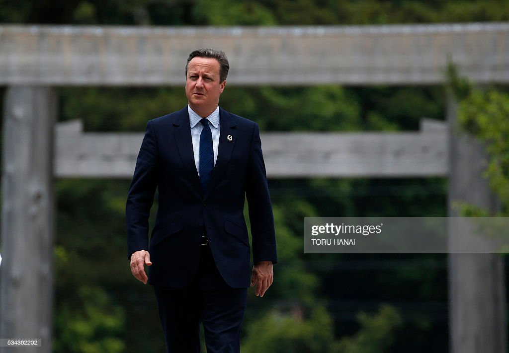 British Prime Minister David Cameron (R) walks on Ujibashi bridge as he visits Ise-Jingu Shrine in the city of Ise in Mie prefecture, on May 26, 2016, on the first day of the G7 leaders summit. World leaders kick off two days of G7 talks in Japan on May 26 with the creaky global economy, terrorism, refugees, China's controversial maritime claims, and a possible Brexit headlining their packed agenda. / AFP / POOL / TORU