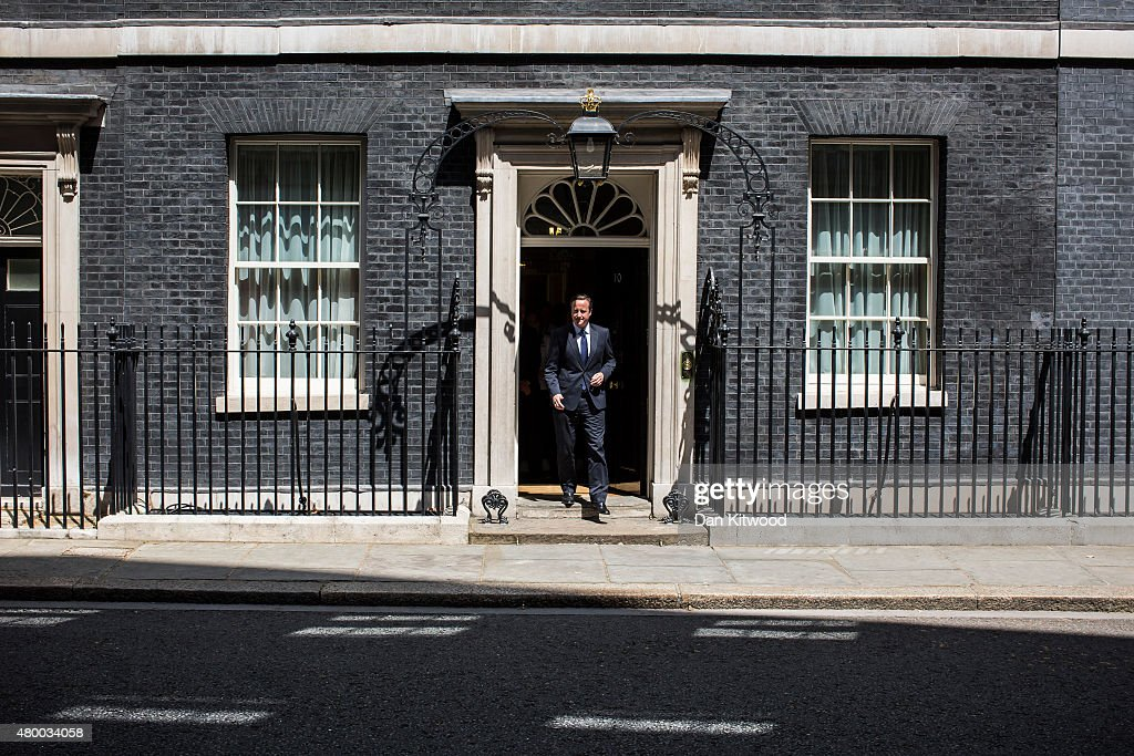 British Prime Minister David Cameron walks out of 10 Downing Street after meeting the England Women's football team on July 9, 2015 in London, England. The England Women's football team met the British Prime Minister David Cameron, and earlier met HRH Prince William after returning home from their Wrold Cup campaign where they came third.