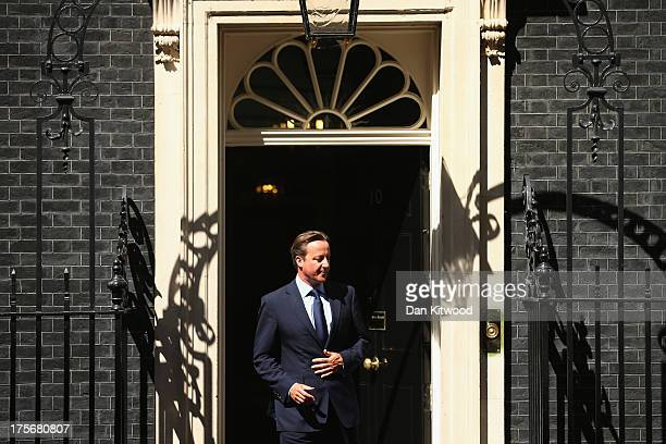 British Prime Minister David Cameron walks through the door of 10 Downing Street to greet King Hamad bin Isa Al Khalifa of Bahrain on August 6 2013...