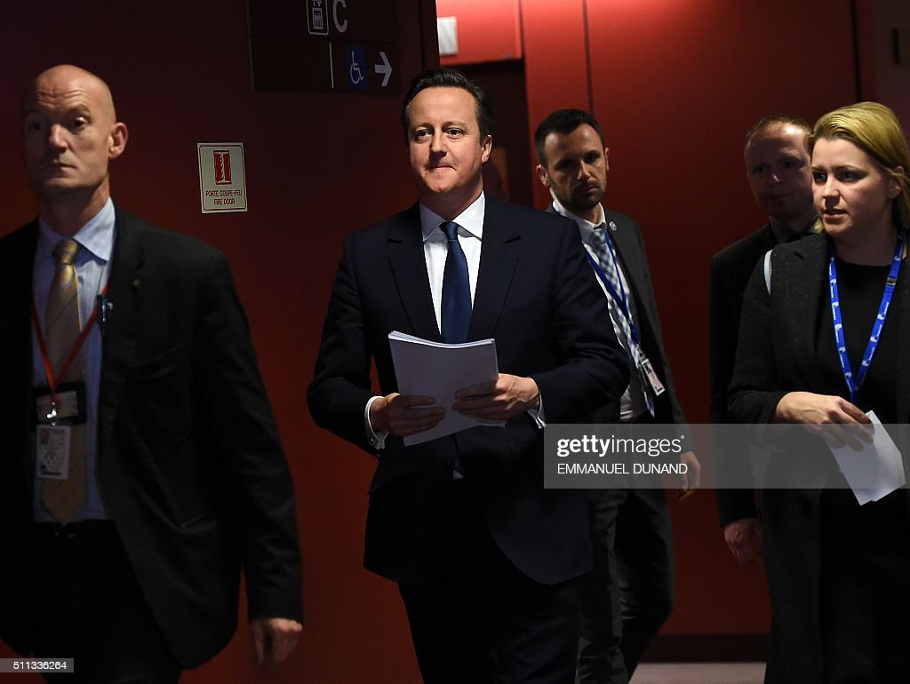 British Prime Minister David Cameron walks to a press conference on February 19, 2016, at end of an European Union (EU) summit in Brussels, after reaching a deal with European leaders on his reforms. The deal, sealed after hours of haggling at a marathon summit, paves the way for a referendum on whether Britain will stay in the EU. The European Union's two top figures, Donald Tusk and Jean-Claude Juncker, presented its 28 leaders with draft proposals at a long-delayed dinner after hours of painstaking face-to-face talks on an issue that threatened place in the union. / AFP / EMMANUEL