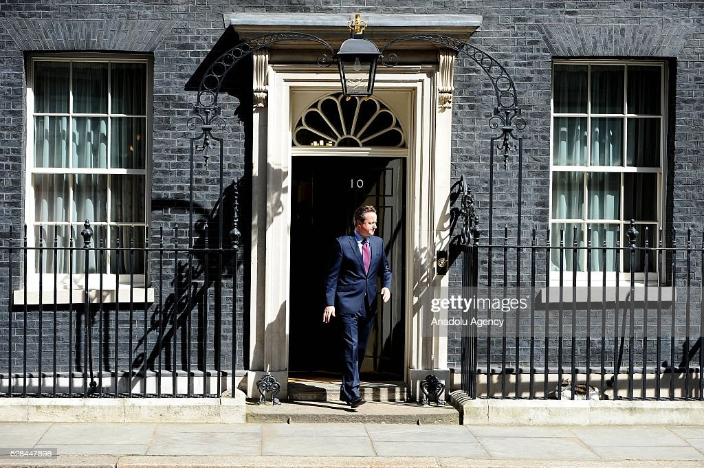 British Prime Minister, David Cameron walks to welcome meets the Prime Minister of Japan, Shinzo Abe, at Downing Street on May 5, 2016 in London, England. Mr Abe is the current serving Prime Minister of Japan and was re-elected to the position in December 2012.