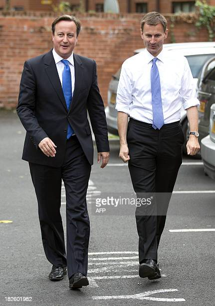 British Prime Minister David Cameron walks with Secretary of State for Health Jeremy Hunt during a visit to the Range Medical Centre in Whalley Range...