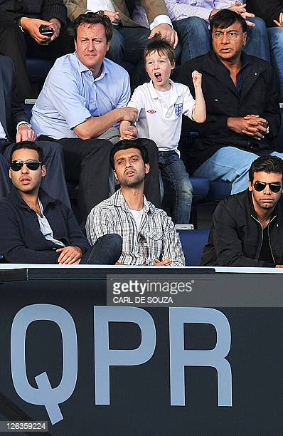 British Prime Minister David Cameron watches as his son Arthur reacts along with Indian Steel magnate Lakshmi Mittal as Aston Villa score during a...