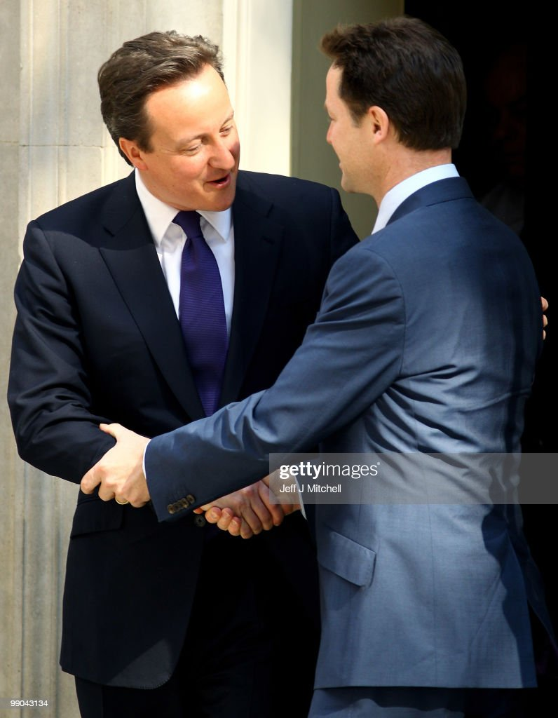 British Prime Minister David Cameron welcomes Deputy Prime Minister Nick Clegg (R) to Downing Street for their first day of coalition government on May 12, 2010 in London, England. After a tightly contested election campaign and five days of negotiation a Conservative and Liberal Democrat coalition government has been confirmed.