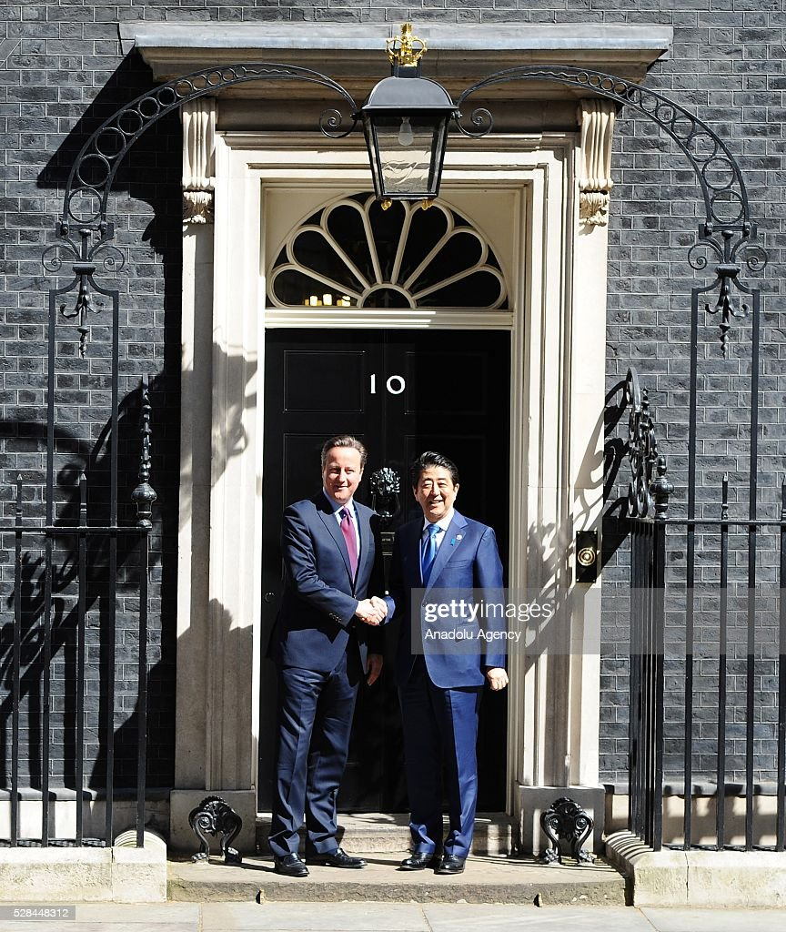 British Prime Minister, David Cameron (L) welcomes the Prime Minister of Japan, Shinzo Abe, at Downing Street on May 5, 2016 in London, England. Mr Abe is the current serving Prime Minister of Japan and was re-elected to the position in December 2012.