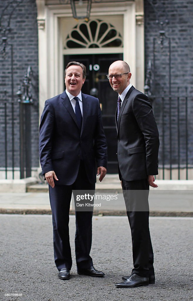 British Prime Minister <a gi-track='captionPersonalityLinkClicked' href=/galleries/search?phrase=David+Cameron+-+Politician&family=editorial&specificpeople=227076 ng-click='$event.stopPropagation()'>David Cameron</a> welcomes Ukrainian Prime Minister Arseniy Yatseniuk to 10 Downing Street on July 15, 2015 in London, England. Mr Cameron and Mr Yatseniuk spoke during a meeting about the ongoing crisis in Ukraine.