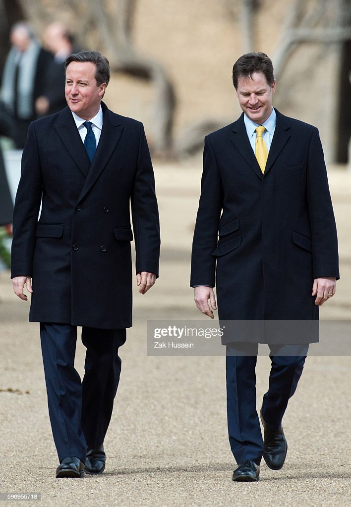 British Prime Minister David Cameron with Deputy Prime Minister and Liberal Democrats leader Nick Clegg attending a ceremonial welcome for The...