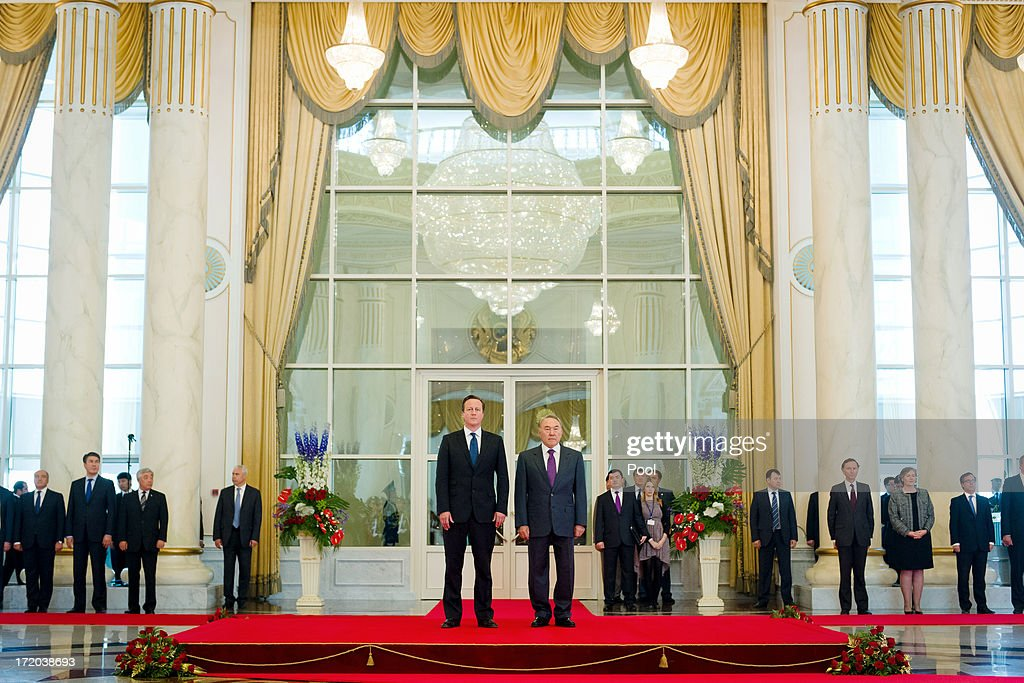 British Prime Minister David Cameron (centre L) with Kazakhstan President Nursultan Nazarbayev (centre R) as they listen to the nationl anthem at the Presidential Palace on July 1, 2013 in Astana, Kazakhstan. Cameron is visiting Kazakhstan as part of a trade mission; the first ever trip to the country by a serving British Prime Minister, after making an unannounced trip to visit troops in Afghanistan and meeting with the Prime Minister of Pakistan in Islamabad.