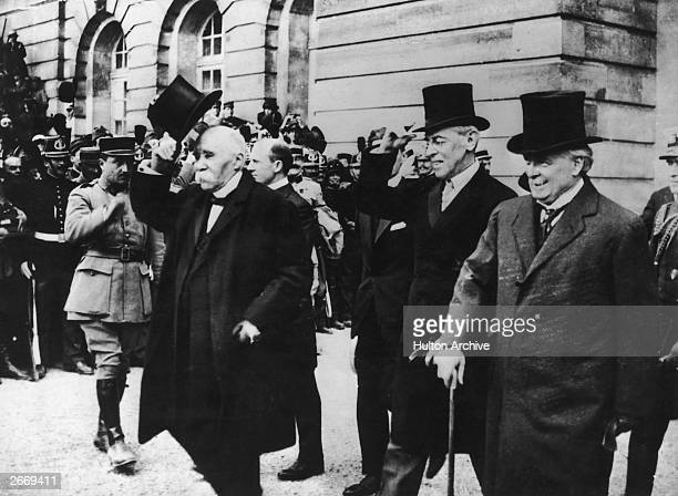 British Prime Minister David Lloyd George right American President Woodrow Wilson centre and French Prime Minister Georges Clemenceau attend the...