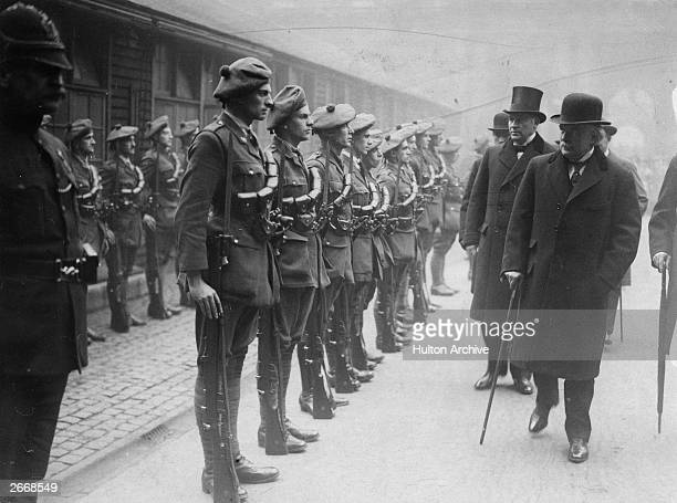 British prime minister David Lloyd George with his cabinet colleagues Andrew Bonar Law and Sir Hamar Greenwood inspecting officer cadets of the...