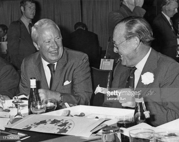 British Prime Minister Edward Heath eating a picnic lunch with Prince Bernhard of the Netherlands during the annual conference of the Institute of...
