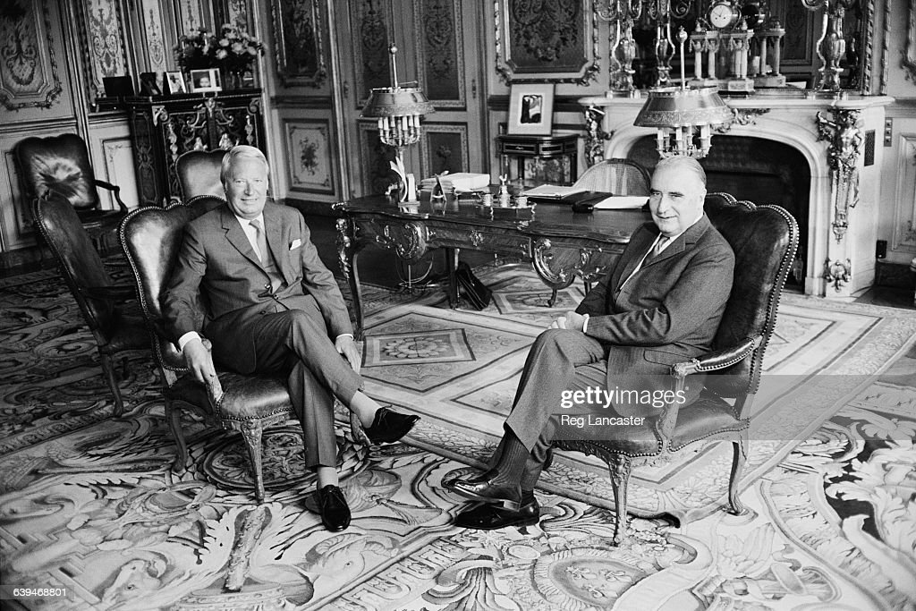 British Prime Minister Edward Heath in conference with French President Georges Pompidou in Pompidou's study Paris France 19th May 1971