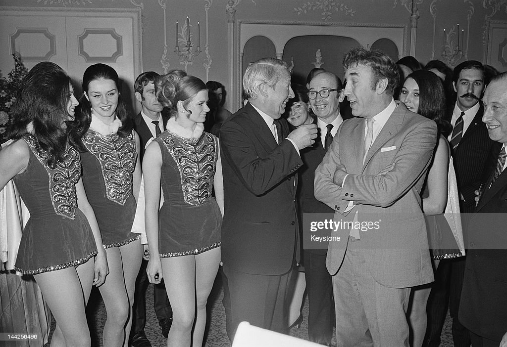 British Prime Minister Edward Heath meets English actor and comedian Frankie Howerd at a Variety Club of Great Britain Christmas luncheon at the...
