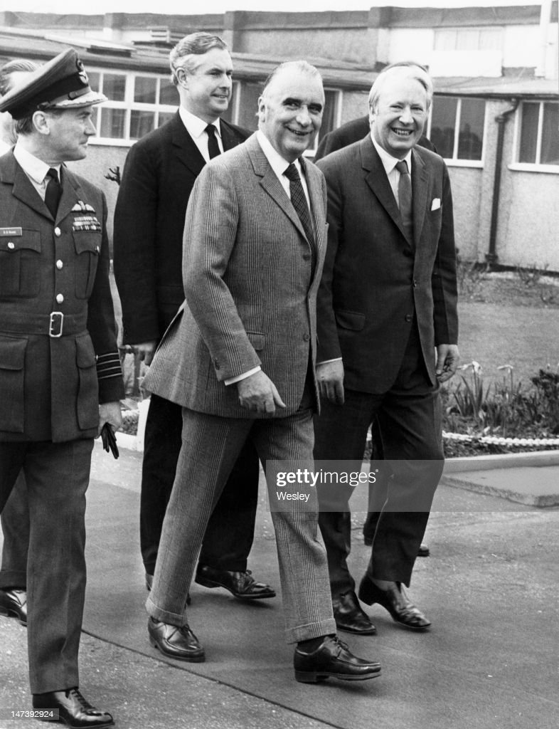 British Prime Minister <a gi-track='captionPersonalityLinkClicked' href=/galleries/search?phrase=Edward+Heath&family=editorial&specificpeople=158692 ng-click='$event.stopPropagation()'>Edward Heath</a> (1916 - 2005, right) meets French President <a gi-track='captionPersonalityLinkClicked' href=/galleries/search?phrase=Georges+Pompidou&family=editorial&specificpeople=216523 ng-click='$event.stopPropagation()'>Georges Pompidou</a> (1911 - 1974, centre) on his arrival at RAF Northolt, Ruislip, London, 18th March 1972. The two premiers are to hold a weekend of meetings at Chequers.