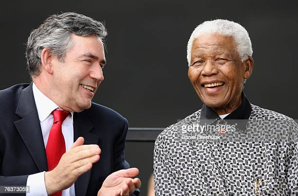 British Prime Minister Gordon Brown applauds exSouth African President Nelson Mandela during a statue unveiling ceremony in Nelson Mandela's honour...