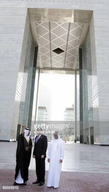 British Prime Minister Gordon Brown listens to director general of Dubai's International Financial Centre Omar bin Suleiman infront if the main gate...
