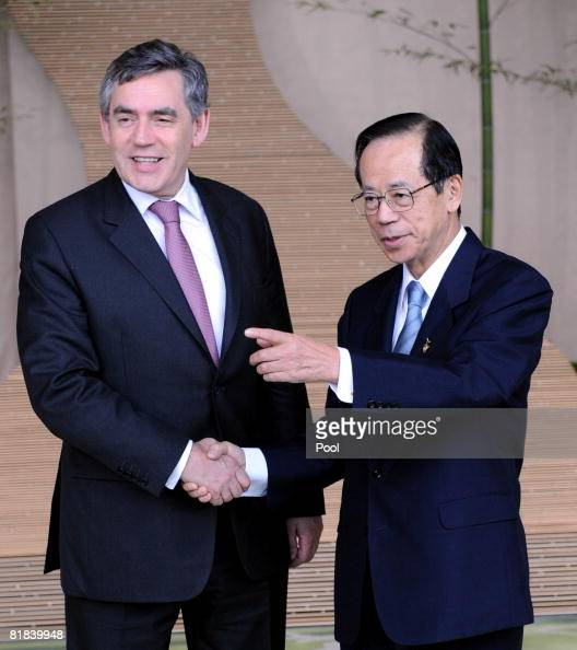 British Prime Minister Gordon Brown shakes hand with Japanese Prime Minister Yasuo Fukuda upon arrival at the Windsor Hotel Toya on July 7 2008 in...