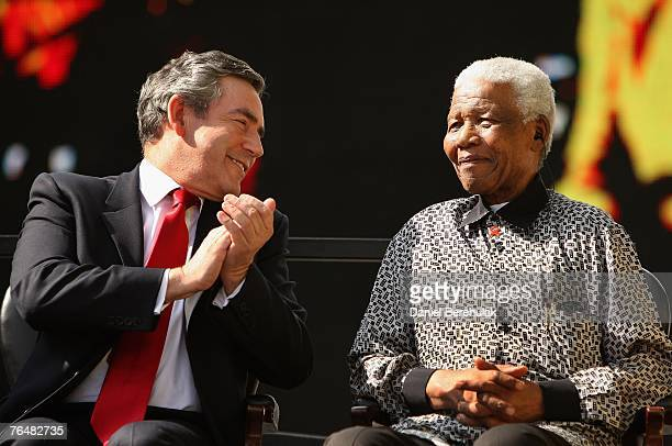 British Prime Minister Gordon Brown smiles with exSouth African President Nelson Mandela during a statue unveiling ceremony in Nelson Mandela's...