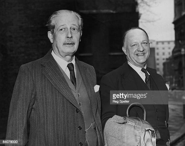 British Prime Minister Harold Macmillan and Home Secretary Rab Butler arrive at Number 10 Downing Street for a cabinet meeting regarding the budget...