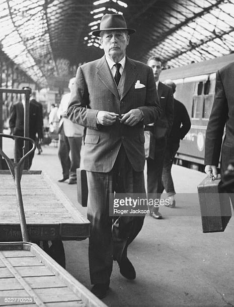 British Prime Minister Harold Macmillan walking long the platform at Euston Station London June 10th 1963