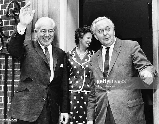 British Prime Minister Harold Wilson and Australian Prime Minister Harold Holt smiling and waving outside 10 Downing Street London July 11th 1966