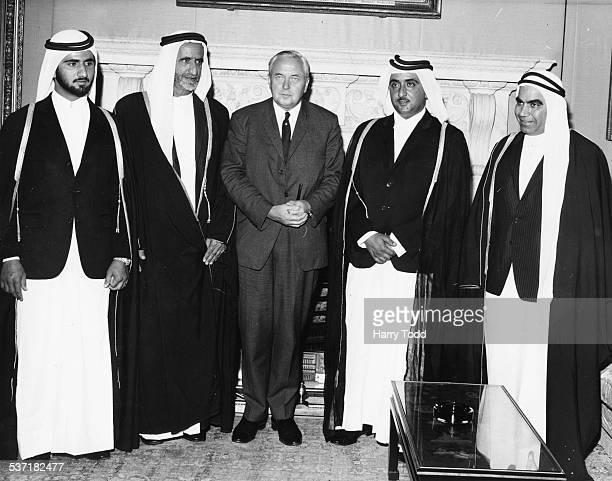 British Prime Minister Harold Wilson with Sheikh Mohammed Sheikh Rashid Bin Said al Maktum Sheikh Maktum and Sayed Mahdi Al Tajir at 10 Downing...