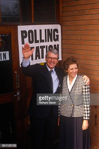 British Prime Minister John Major and wife Norma stand outside his constituency polling station while seeking reelection after replacing Margaret...