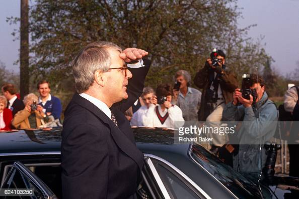 British Prime Minister John Major looks into the distance while outside his constituency polling station while seeking reelection after replacing...