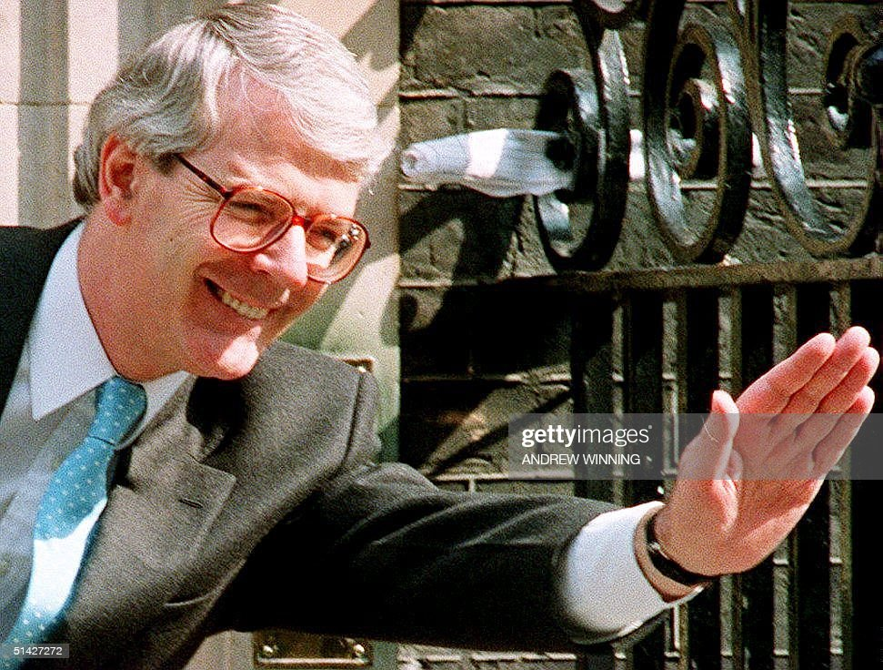 British Prime Minister John Major waves to visitors, 10 May 1994, at 10 Downing Street in London. Major is coming under increasing preasure to call a referendum on closer ties with Europe and is expected to face questions on the matter later 10 May during the prime minister's question time in the House of Commons.