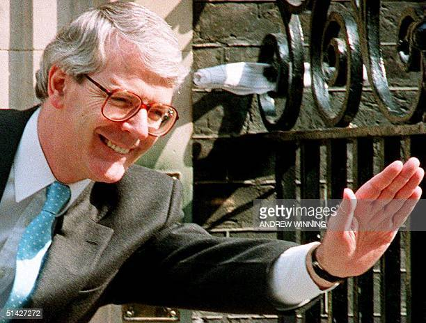 British Prime Minister John Major waves to visitors 10 May 1994 at 10 Downing Street in London Major is coming under increasing preasure to call a...