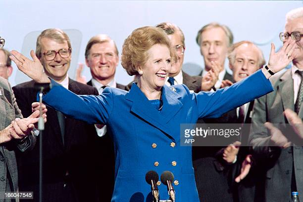 British Prime Minister Margaret Thatcher acknowledges applauds on Ocotber 13 1989 at the end of the Conservative Party conference in Blackpool At...