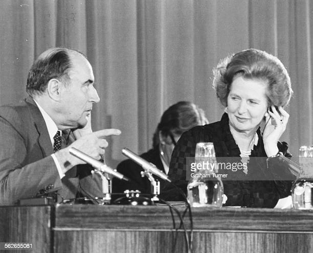 British Prime Minister Margaret Thatcher and French President Francois Mitterand at a press conference about their countries relationship London...