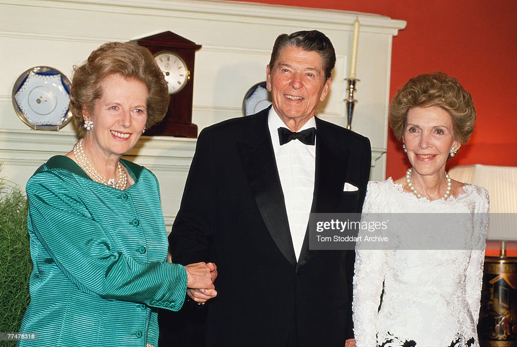 British Prime Minister Margaret Thatcher and US President Ronald Reagan (1911 - 2004) accompanied by the President's wife Nancy Reagan, 1989.