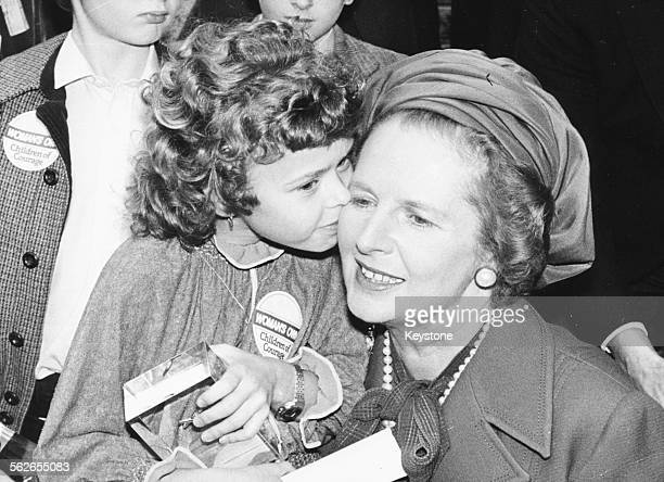 British Prime Minister Margaret Thatcher being kissed on the cheek from young Rachael McCall who has received a bravery award for rescuing her...